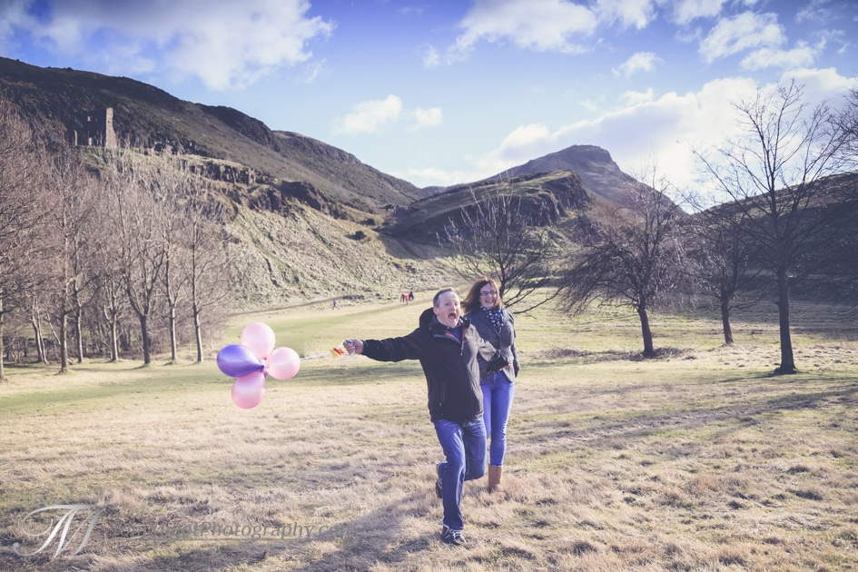 Fun couple portrait in Holyrood park in Edinburgh scotland